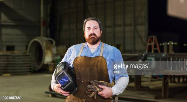 welder in metal fabrication factory - macho stock pictures, royalty-free photos & images