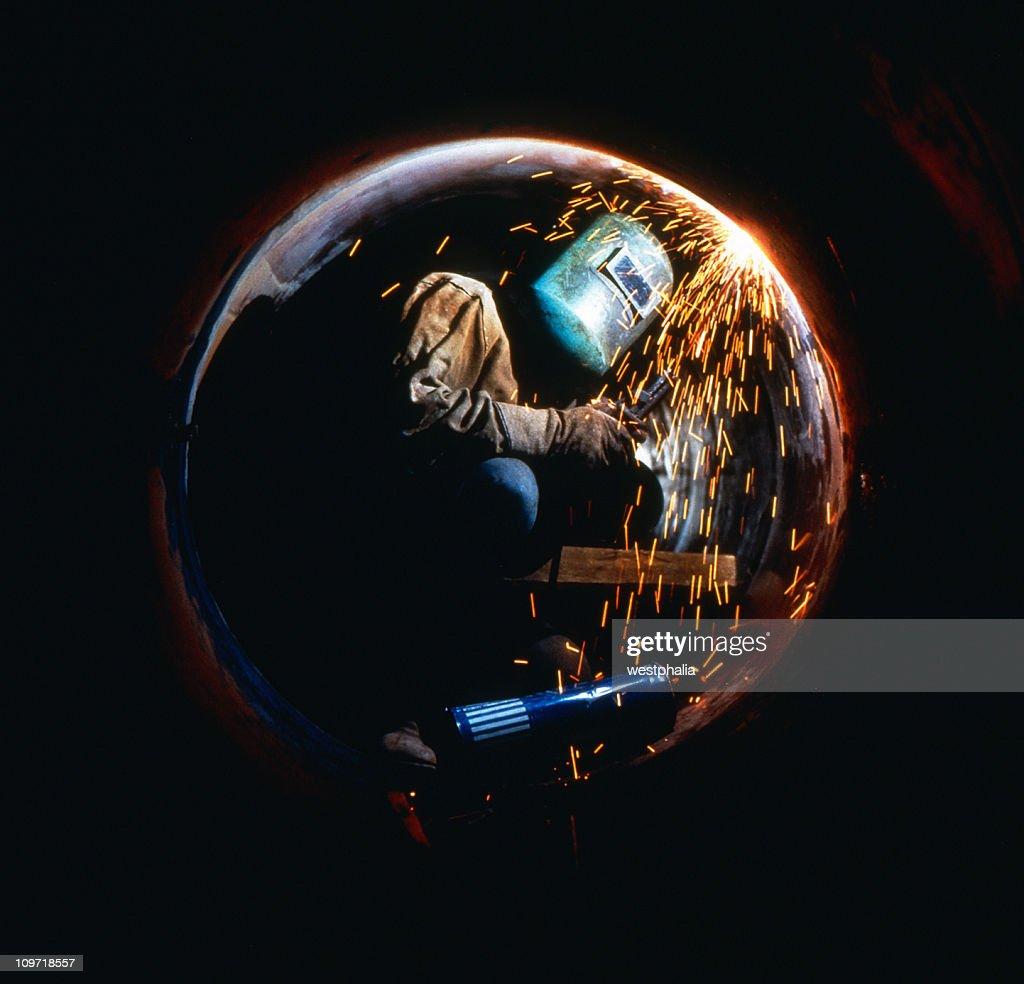 Welder in Pipe : Stock Photo