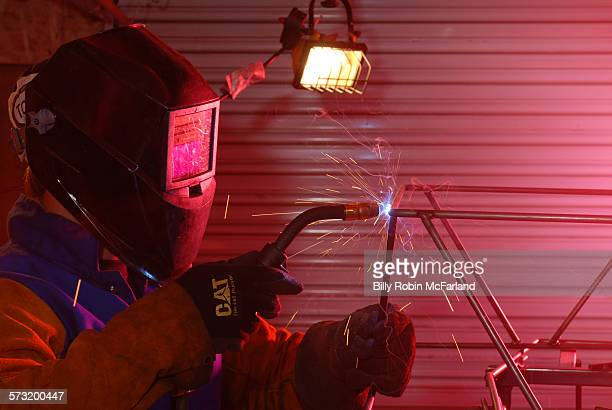 Welder in welding mask