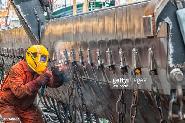 welder is welding the wall of a ship - north holland stock pictures, royalty-free photos & images
