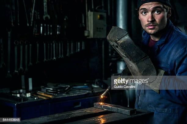 Welder soldering iron in workshop