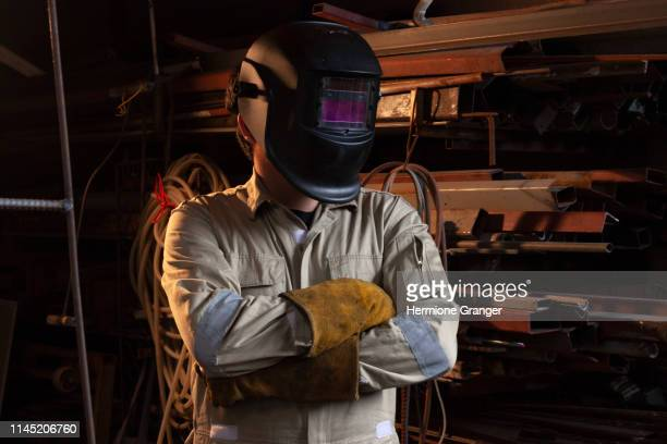 welder steel welding worker industry factory spark work safety job mask labor occupation - fabricage apparatuur stock pictures, royalty-free photos & images