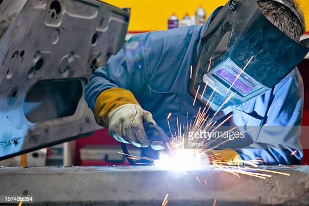 welder uses torch on car he is welding - labor union stock pictures, royalty-free photos & images