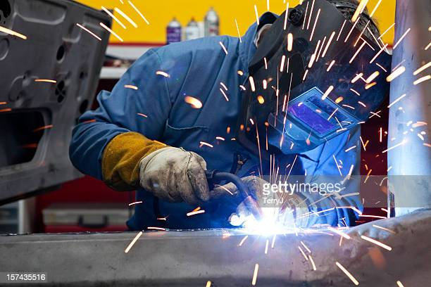 welder uses torch on car he is welding - welding stock photos and pictures