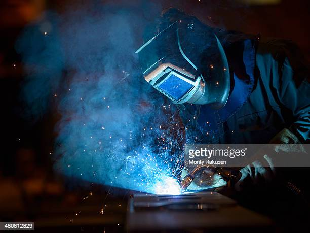 welder using oxyacetylene torch in factory - welding stock photos and pictures