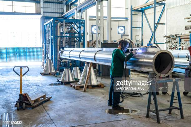 welder welding stainless steel big pipe - industrial equipment stock pictures, royalty-free photos & images