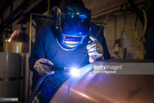 welder welding stainless steel tank at industry - stainless steel stock pictures, royalty-free photos & images