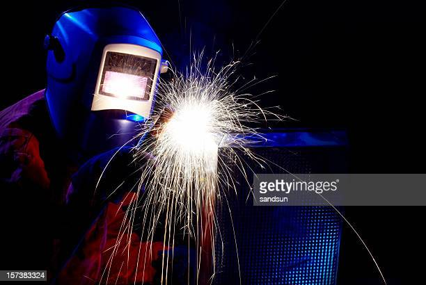 Welder with mask welding metal in dark room