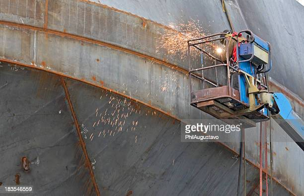 Welder with torch at shipbuilder's yard