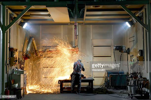 welder working in a factory - welding stock photos and pictures