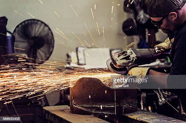 Welder working in metal workshop