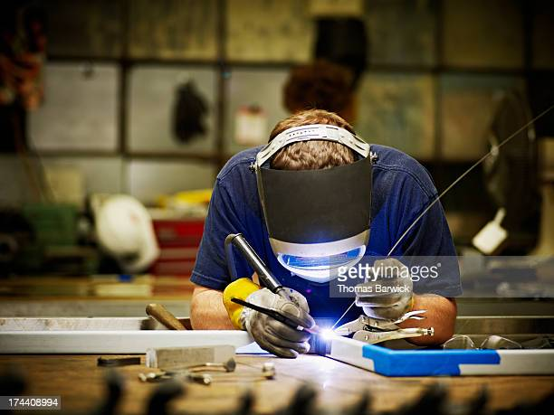 Welder working in sheet metal shop