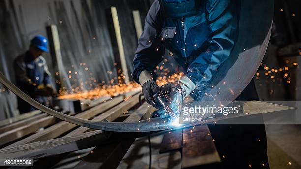 welder working in workshop - welding stock photos and pictures
