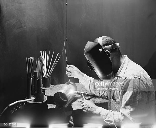welder working on metal pipe - archival stock pictures, royalty-free photos & images