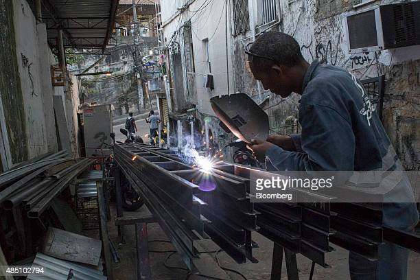 A welder works in an alley in the Rocinha favela in Rio de Janeiro Brazil on Thursday Aug 20 2015 With joblessness on the rise and abovetarget...
