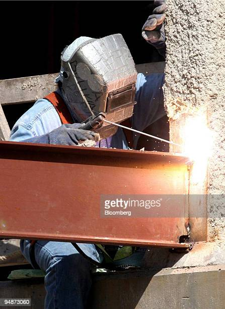 A welder works on a large piece of steel at the Chevy Chase Center construction site on Monday October 3 2005 in Chevy Chase Maryland