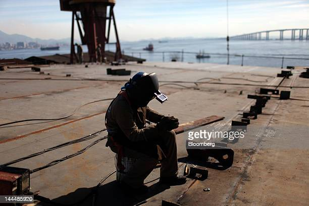 A welder works on the deck of a Petroleo Brasileiro SA oil tanker under construction at the Maua SA shipyard in Niteroi Brazil on Thursday May 10...