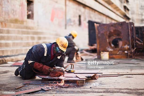 Welders at work on dry dock