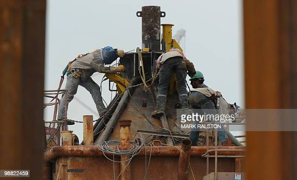 Welders at work on the Pollution Control Dome being built by steelworkers at the Martin Terminal worksite in Port Fourchon as BP rushes to cap the...