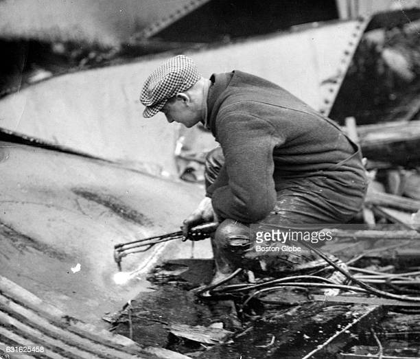 Welders carefully began cutting up the molasses tank with torches in the search for bodies on Jan 20 five days after the Great Molasses Flood in...