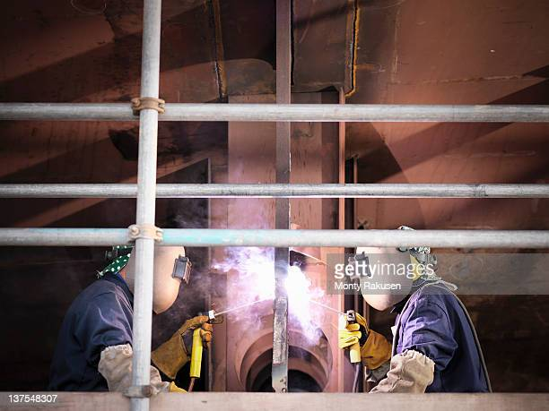 welders on ship - industrial sailing craft stock pictures, royalty-free photos & images