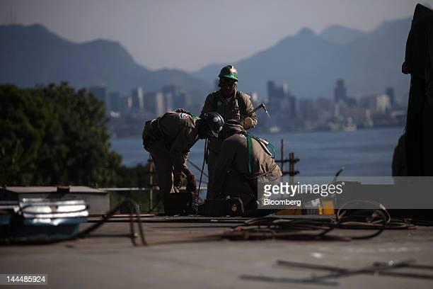 Welders work on a Petroleo Brasileiro SA oil tanker under construction at the Maua SA shipyard in Niteroi Brazil on Thursday May 10 2012 The...