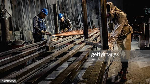 welders working in workshop - metallic boot stock pictures, royalty-free photos & images