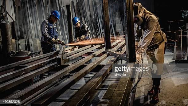welders working in workshop - metallic shoe stock pictures, royalty-free photos & images