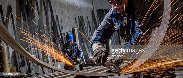 Welders working in workshop
