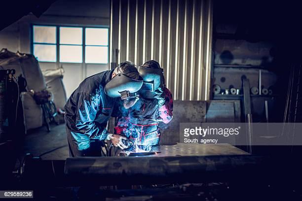 Welders working together
