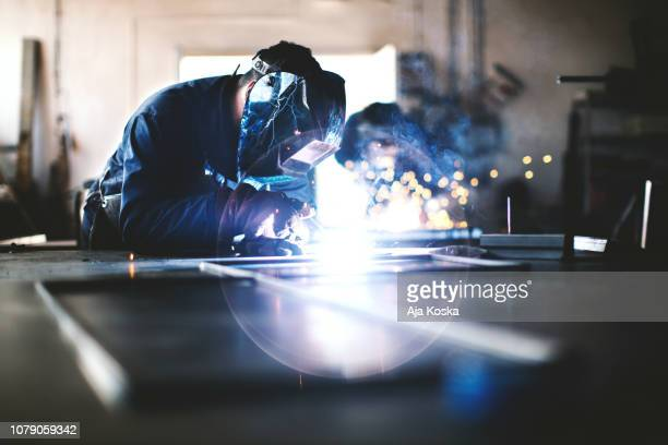 welding and grinding. - metal industry stock pictures, royalty-free photos & images