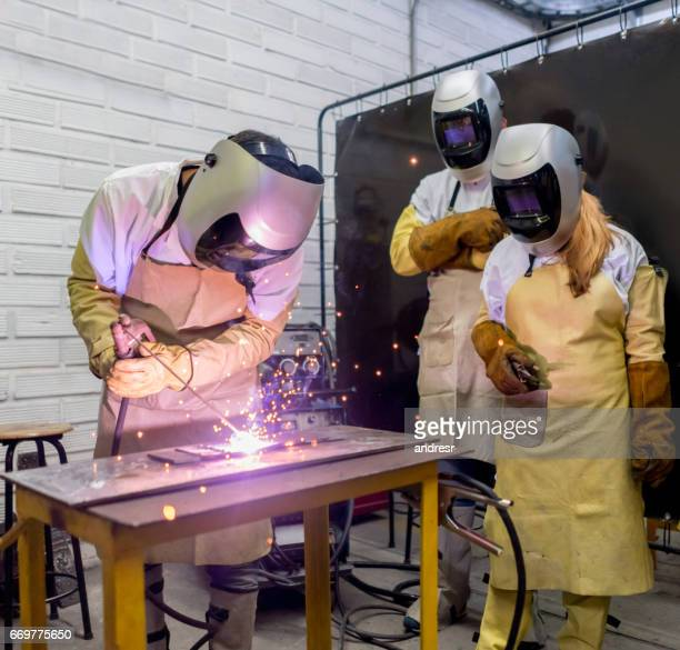 welding class at college - welding stock photos and pictures
