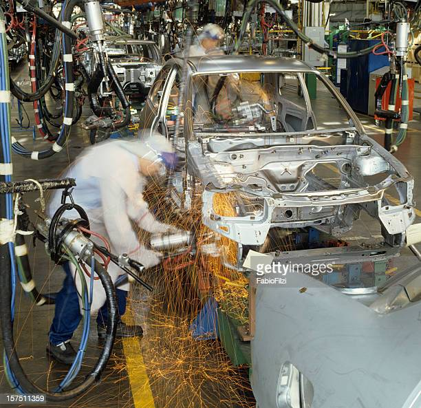 welding during the production line of an automobile  - fabio filzi stock photos and pictures