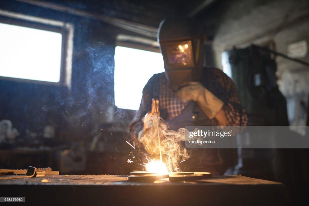 Welding in smithy : Stock Photo