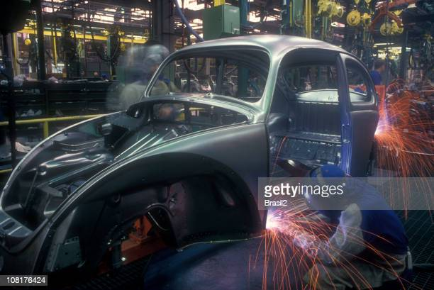 Welding on an assembly line in an automotive factory