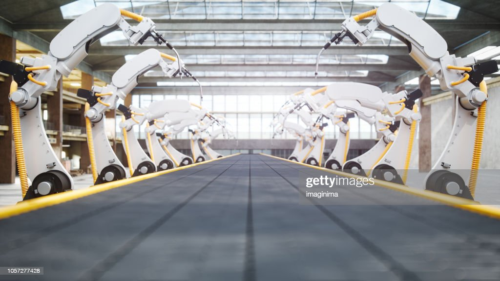 Welding Robots And Conveyor Belt In Automated Factory : Stock Photo