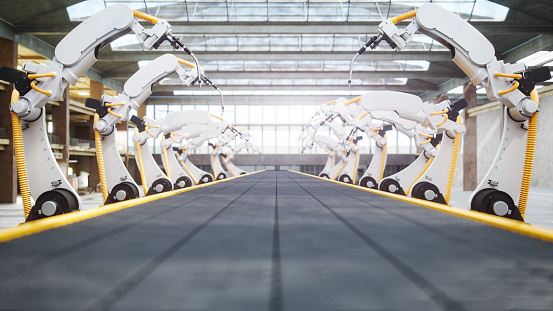 Welding Robots And Conveyor Belt In Automated Factory - gettyimageskorea