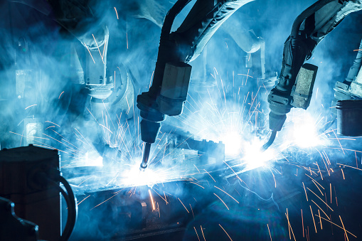Welding robots movement in a car factory 1054184002