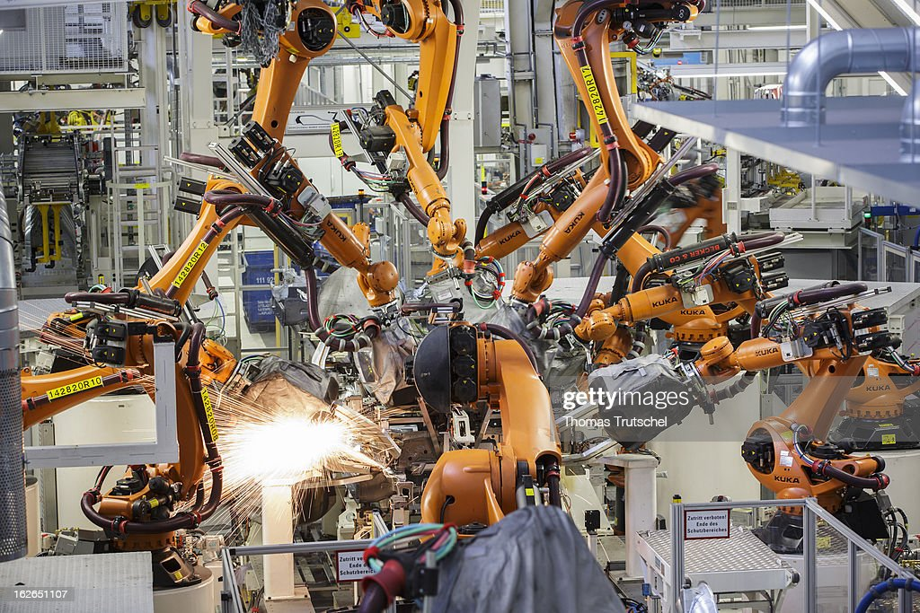 Welding robots work on new Volkswagen Golf 7 cars at the Volkswagen factory on February 25, 2013 in Wolfsburg, Germany. Volkswagen Aktiengesellschaft announced its key financial data for fiscal year 2012 with sales revenue of EUR 192.7 billion (prior year: EUR 159.3 billion), the Group's operating profit of EUR 11.5 billion (EUR 11.3 billion) exceeded the prior-year record level.