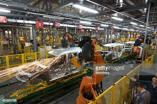 Welding robots work on the body shells of Lada Largus automobiles as they move along the assembly line at the OAO AvtoVAZ plant controlled by Renault...