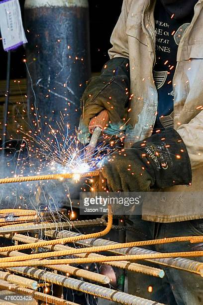 Welding sparks.. Heavy industry on metal re-bar fabrication.