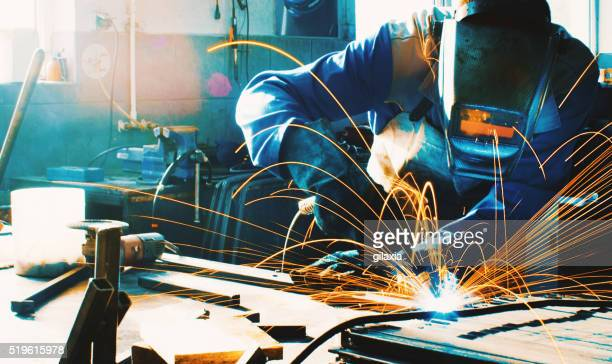 welding two pieces of metal. - welding stock photos and pictures