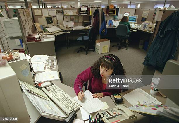 WELFARELinda Hernandez a former welfare recipient answers phones at the Parkway office of the Oregon Department of Human Resources in Salem Oregon...