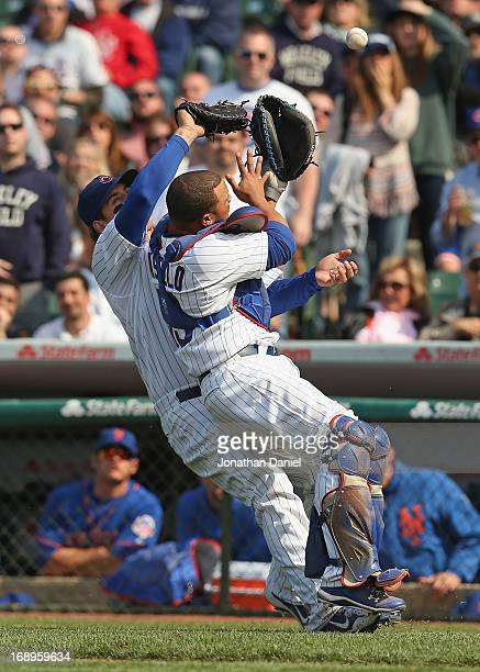 Welington Castillo and Anthony Rizzo of the Chicago Cubs collide trying to catch a foul ball against the New York Mets at Wrigley Field on May 17...