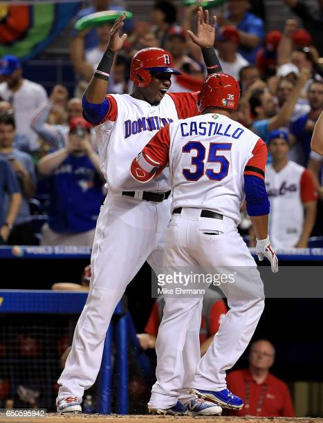 Welington Castillo is congratulated by Gregory Polanco of the Dominican Republic after hitting a two run home run during a Pool C game of the 2017...