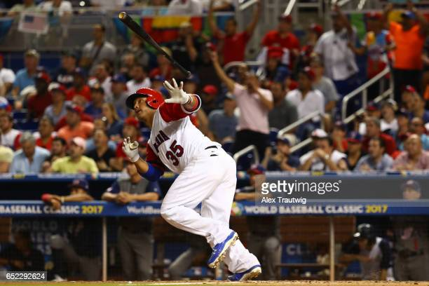 Welington Castillo of Team Dominican Republic hits an RBI double in the seventh inning during Game 4 Pool C of the 2017 World Baseball Classic...