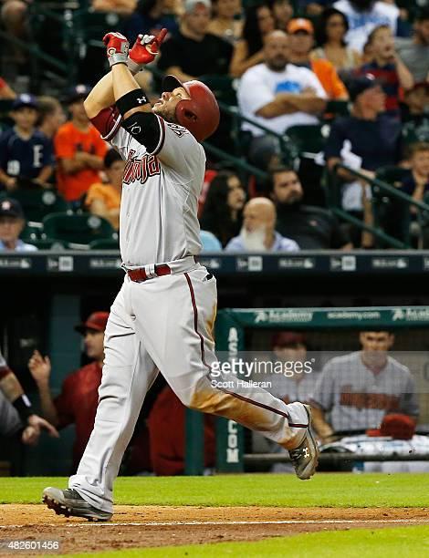 Welington Castillo of the Arizona Diamondbacks celebrates after hitting a solo home run in the tenth inning off Pat Neshek of the Houston Astros...