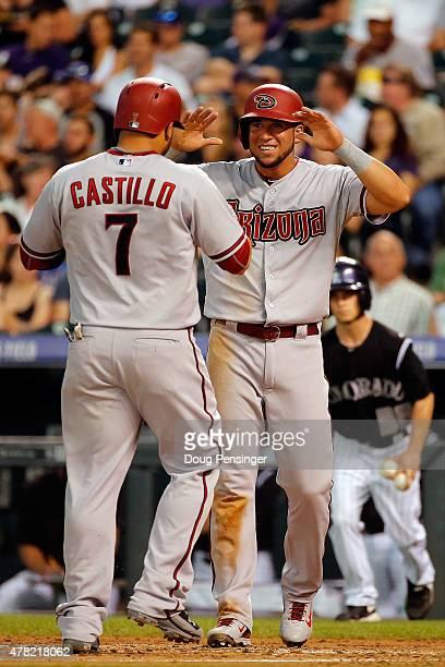 Welington Castillo of the Arizona Diamondbacks celebrates his two run home run off of Kyle Kendrick of the Colorado Rockies with David Peralta of the...