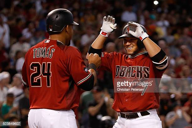 Welington Castillo of the Arizona Diamondbacks highfives Yasmany Tomas after Castillo hit a threerun home run against the Pittsburgh Pirates during...