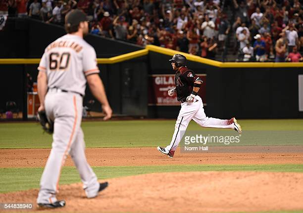 Welington Castillo of the Arizona Diamondbacks rounds the bases after hitting a three run home run in the bottom of the eighth inning off of pitcher...